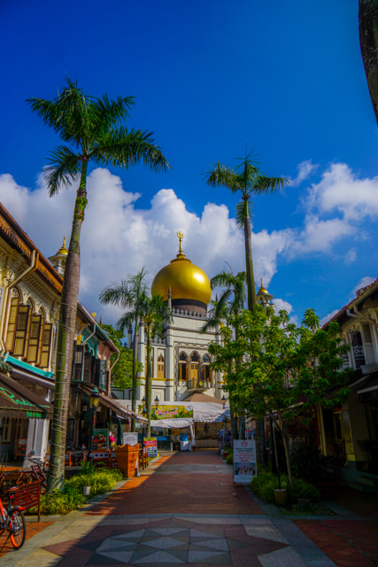 The golden top of the mosque looks very beautiful with the white clouds and blue sky