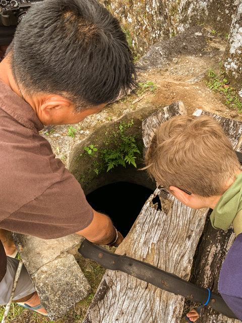 Our guide shows us a well the locals built