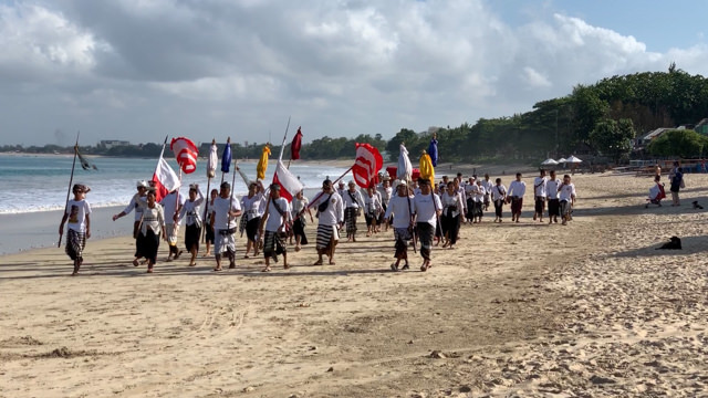 There's a big procession on the beach