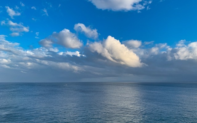 Look at how beautifully the clouds are mirrored on the sea surface