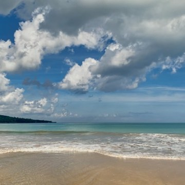 The sea looked like a postcard today! Bright blue water, beautiful cream coloured sandy beach, dark blue sky with a few white clouds.