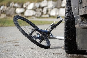 Bicycle accident, wheel in front of car low angle shot, focus on car Lenklypse 2012