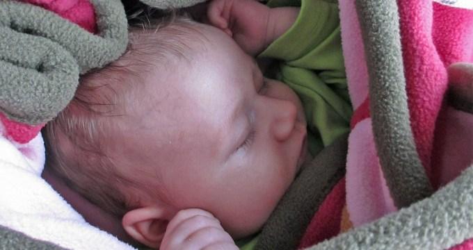 Baby op reis slaapje