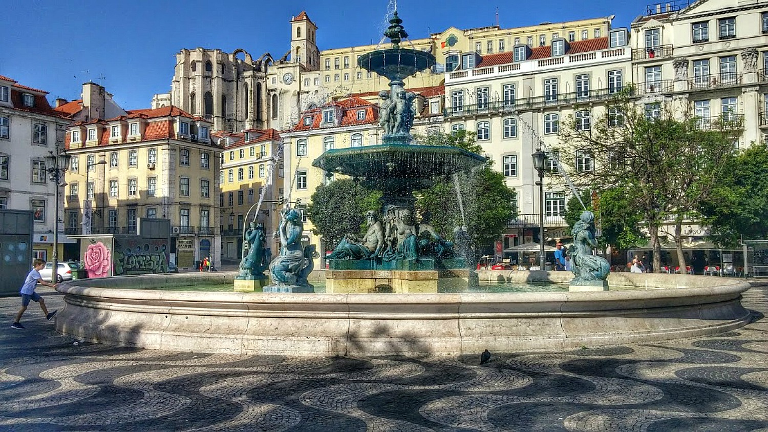 11 Top Reasons to Visit Portugal. Charming architecture of Rossio Square in Lisbon.