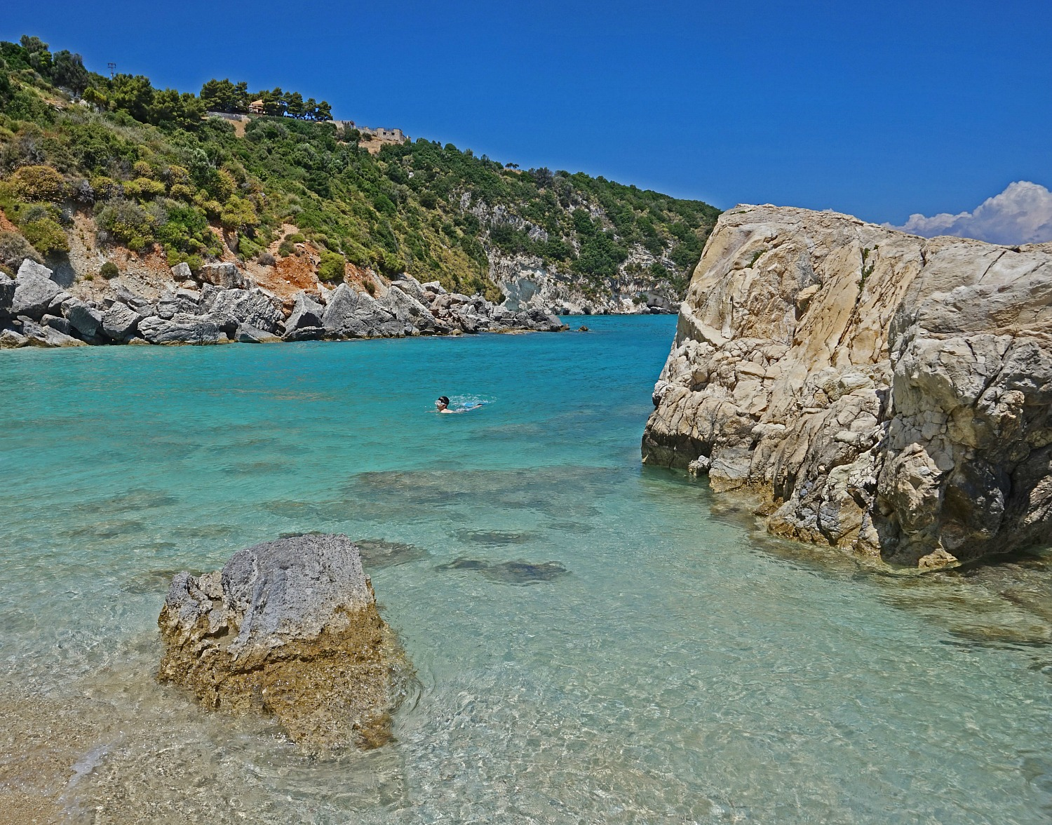 Zakynthos Greece - how to visit. Beach with a large boulder.
