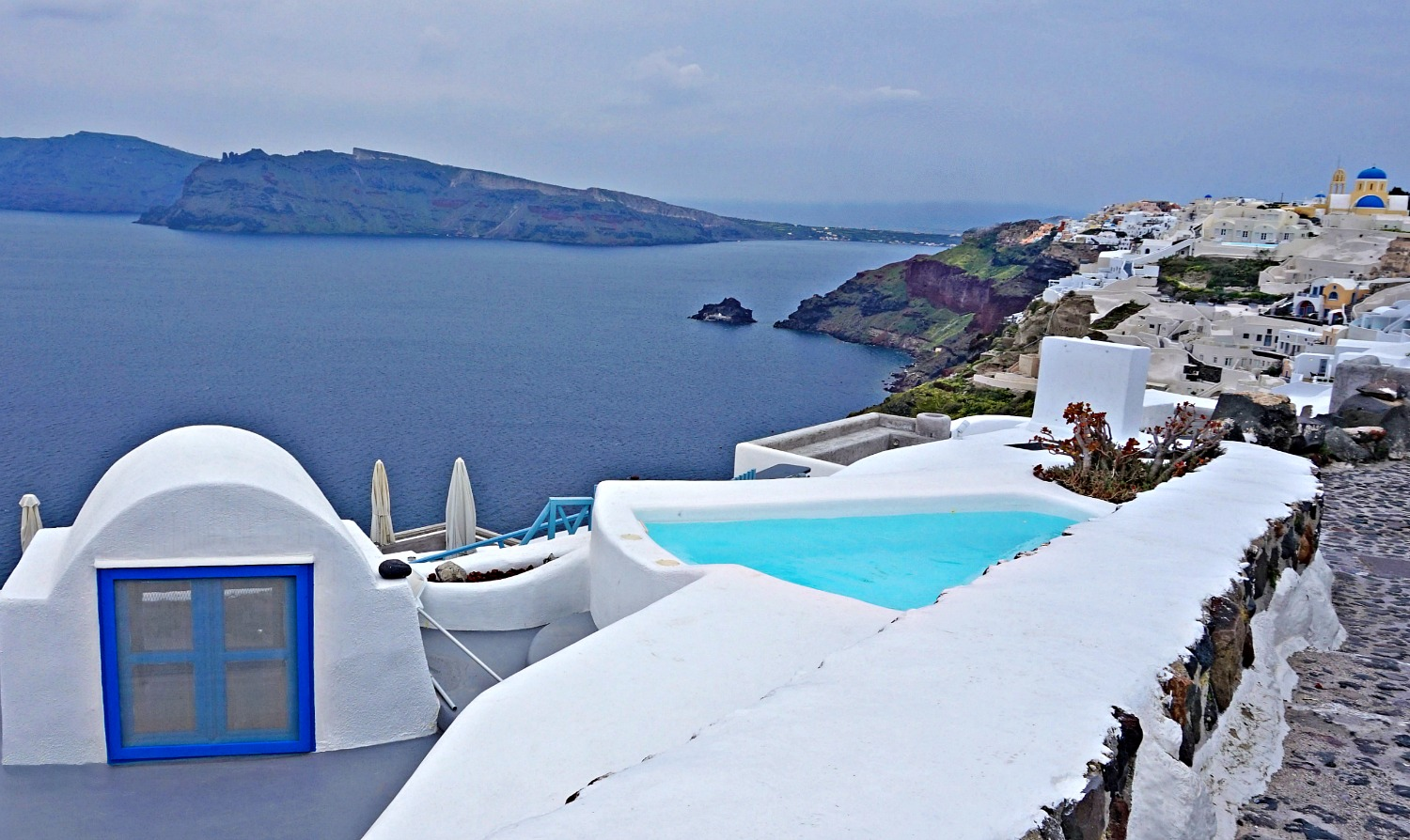 Nice pool near Oia Santorini, as seen from a hiking trail.