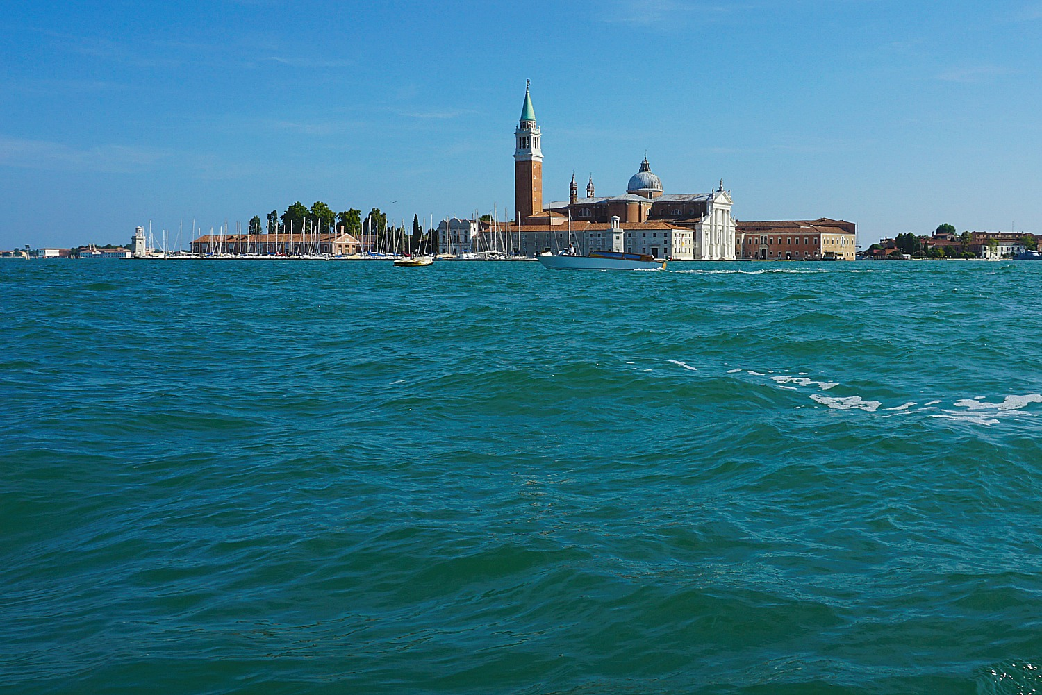 Distance views of Venice from the water.