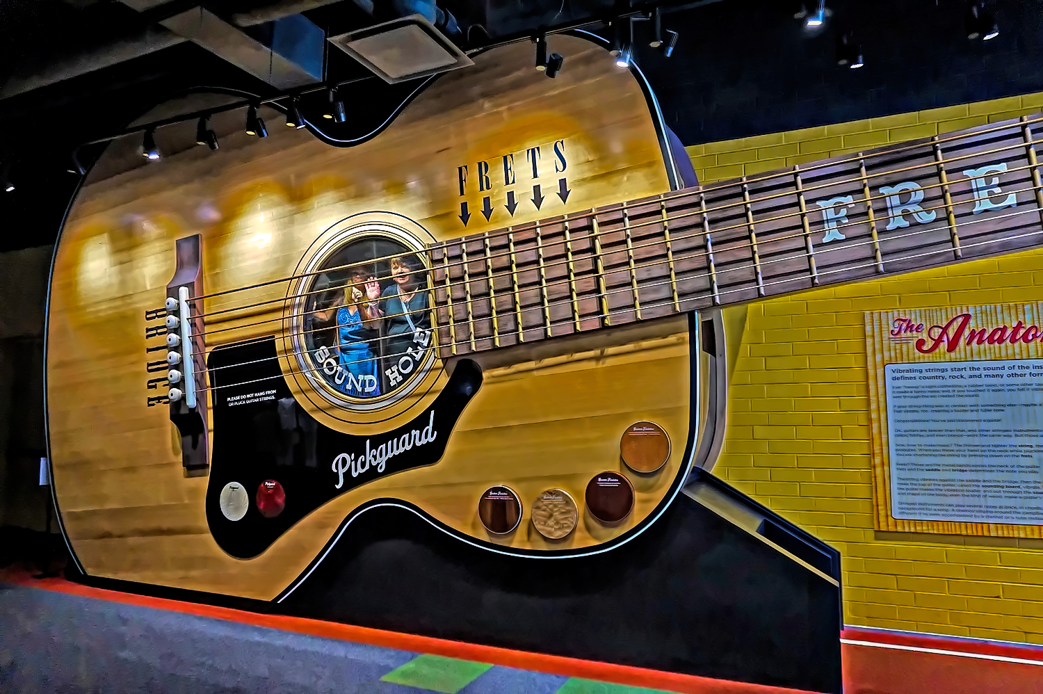 Girls trip to Nashville. A huge guitar in County Music Hall of Fame.