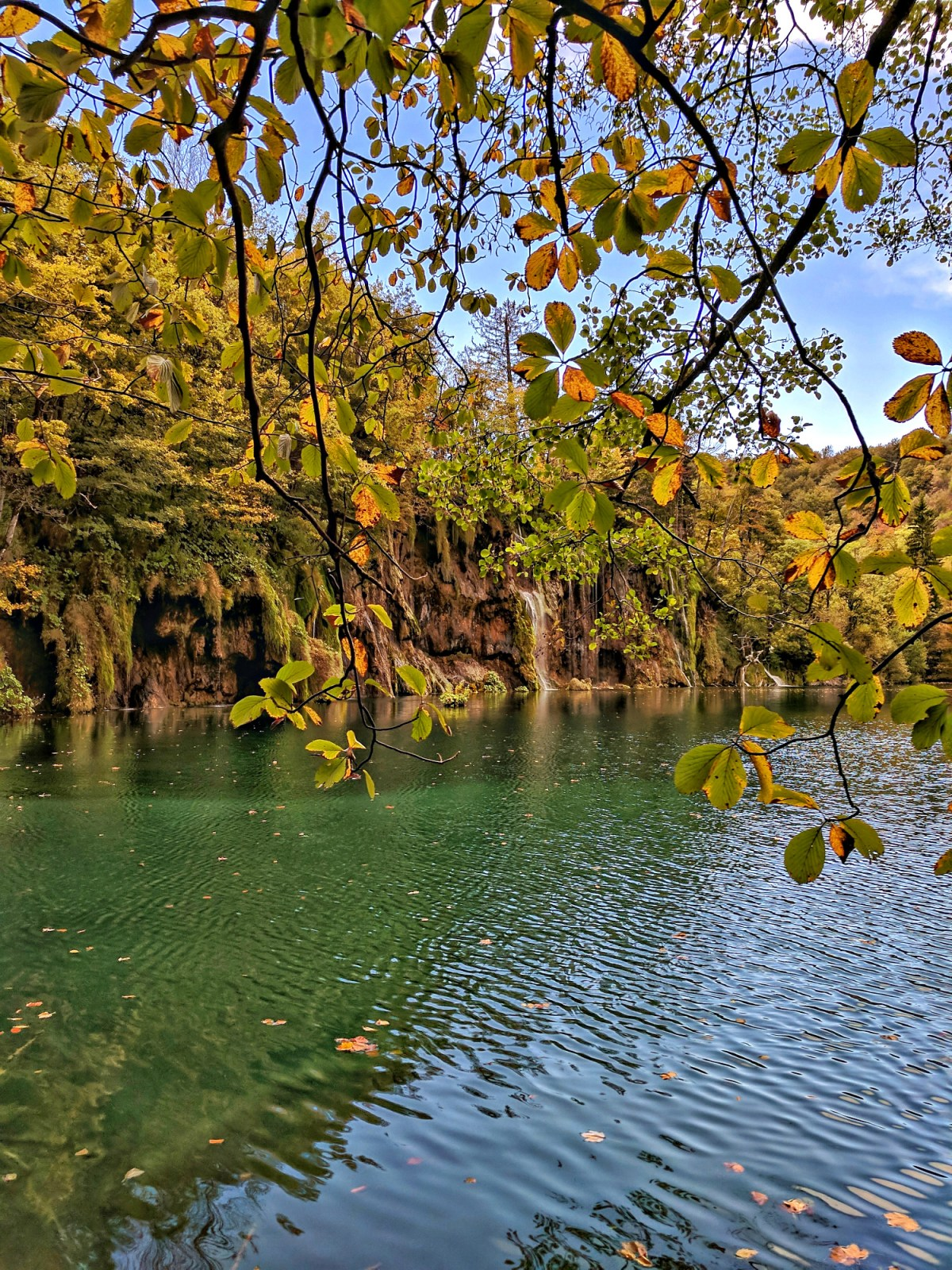 Europe's top natural attraction. View of of the lake through leaves.