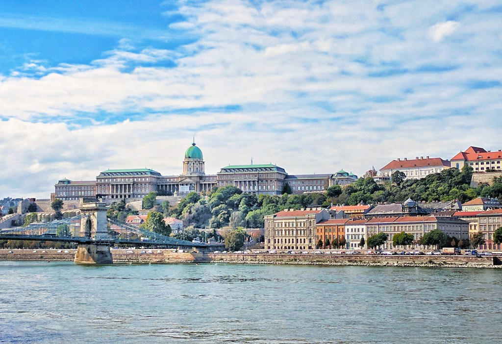 Budapest travel guide. Buda Castle as seen from across the Danube River.