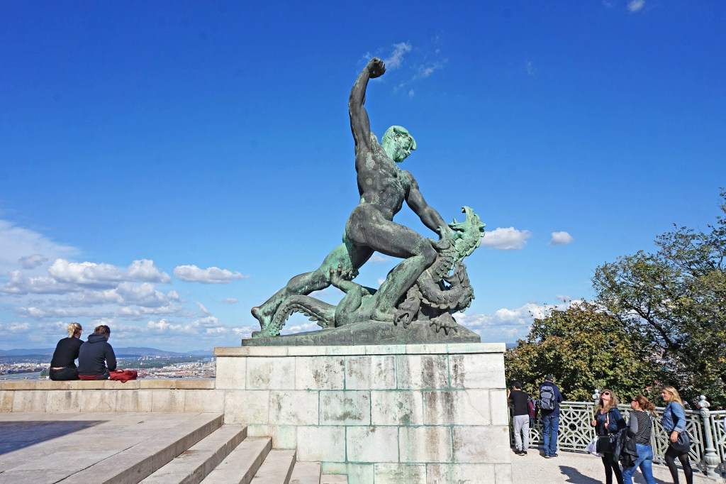 Statue representing the battle with evil, at the base of the Liberation Monument on Gellert Hill, Budapest, Hungary.