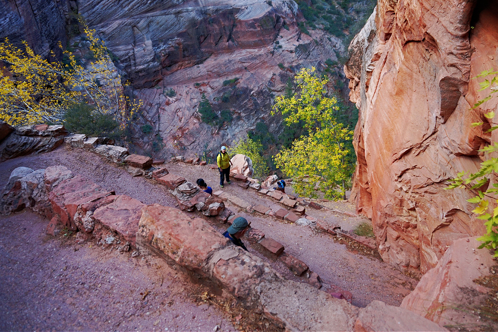 People hiking Angels Landing trail in Zion National Park.