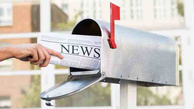 Person Hands Opening Mailbox To Remove Newspaper