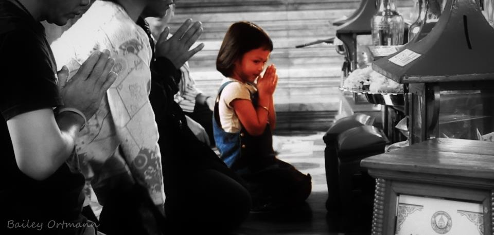 Girl prays in Thailand