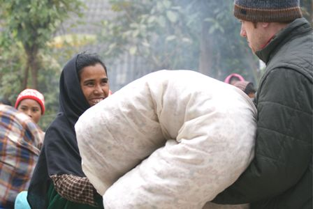missionary gives blanket
