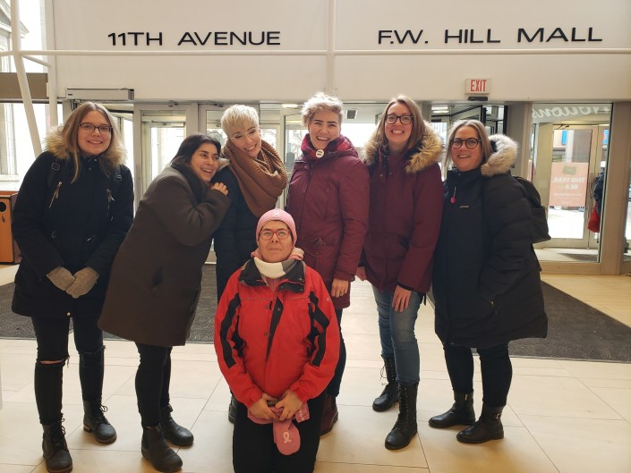 YWCA Regina handing out roses at Cornwall Centre Dec. 6, 2019
