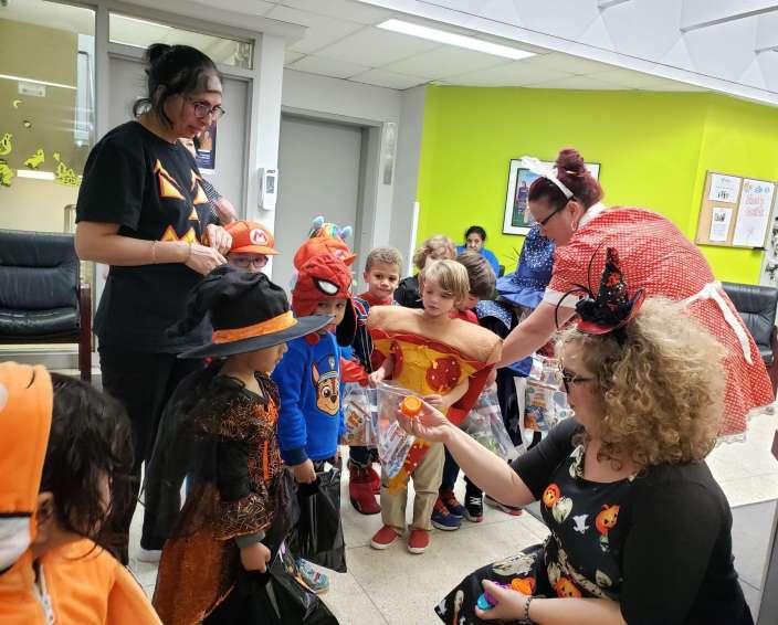 YWCA Regina staff hand out candy to children Halloween 2019