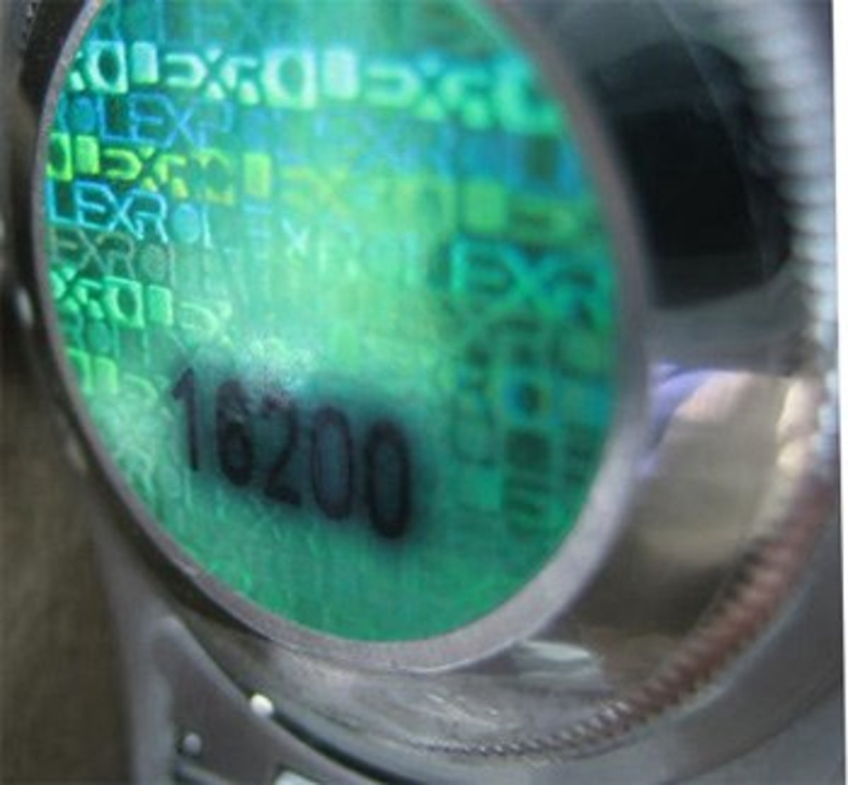 an official Rolex hologram on the back of a Datejust