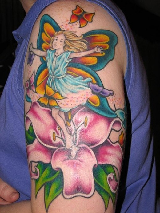 Fairy tattoo design with a lily flower incorporated. Source: http://farm1