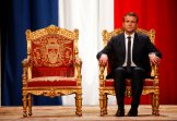 French President Emmanuel Macron listens as Paris Mayor Anne Hidalgo delivers her speech during a ceremony at the Hotel de Ville in Paris, France, Sunday, May 14, 2017. (Charles Platiau/Pool Photo via AP)