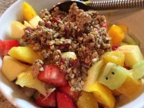 Rawnola topping on fruit salad