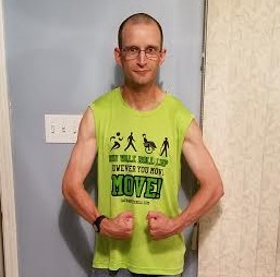"Zachary modelling his lime green sleeveless ""Run, Walk, Roll, Limp However You Move, MOVE!"" shirt, designed using Custom Ink.'s design lab."