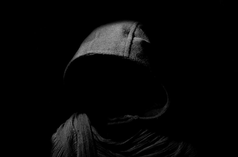 man in black hood