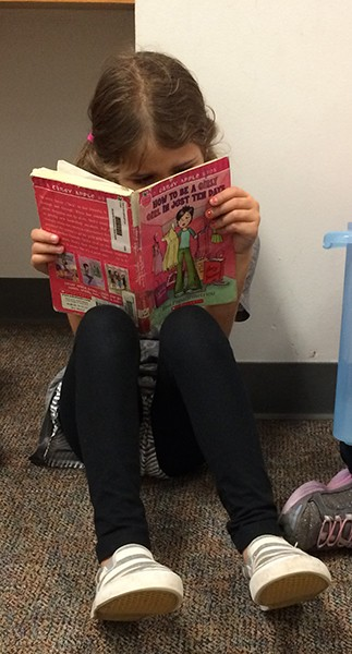 Milly-Reading-at-the-School-Library