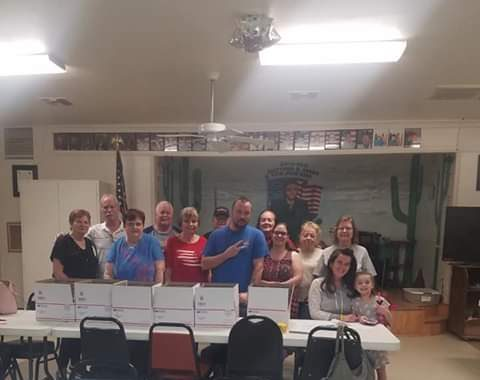 Golden Shores, AZ: Veterans of Foreign Wars Post 6306 and Auxiliary assembled care packages to send to the United States Air Forces Central Air Operations Command currently deployed to Qatar.