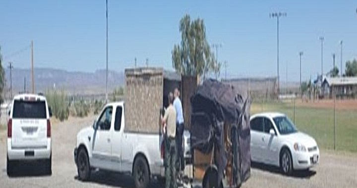 Needles, CA: Deputies arrested three people after finding five children unrestrained in makeshift crate in pickup truck bed.