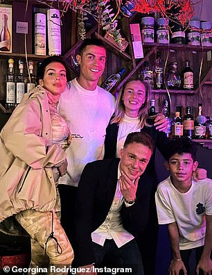 Good times: Earlier that night Ronaldo was joined by Georgina and Cristiano, Jr for a slap-up birthday meal in Turin