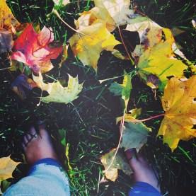 Bare feet on crunchy leaves