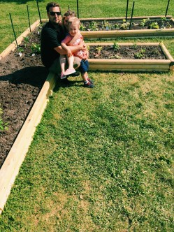 Checking out the garden Daddy made for his school