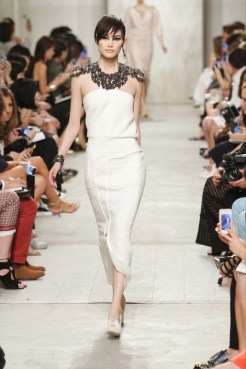 CHANEL resort 2014 Singapore - White dress with black necklace