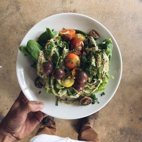 image of Butter lettuce wedge salad with heirloom tomatoes and vegan green goddess dressing.