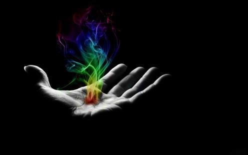 reiki-hand-with-rainbow-fire