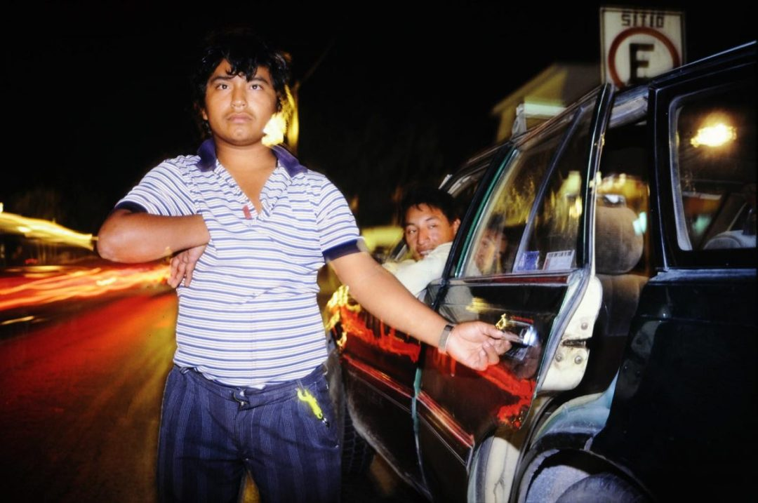 Mexican boy opening car door ©1988  Larry Zamba
