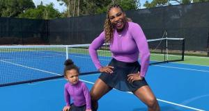 Serena Williams and daughter in matching outfits playing tennis