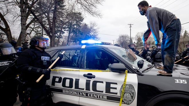 Protests near Minneapolis as police shoot black man dead