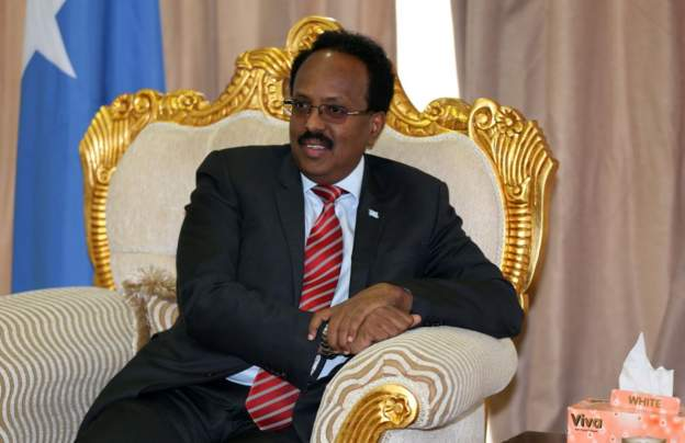Somalia president signs law extending his term in office