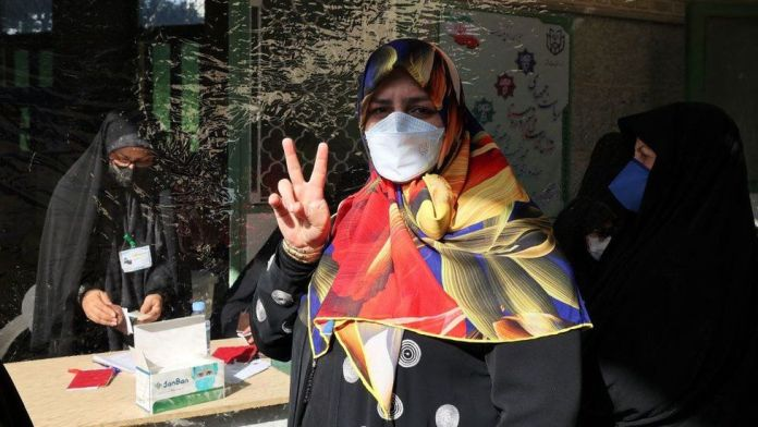Iranians vote in presidential election marred by disqualifications