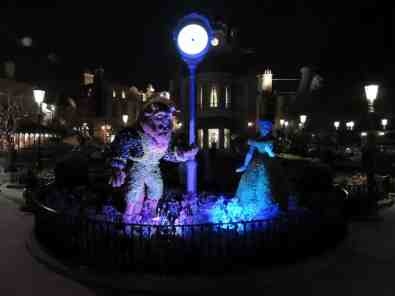 Beauty and the Beast topiaries at night