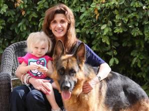 german shepherd dog and family