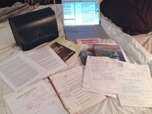 Photo of research materials for Above and Beyond