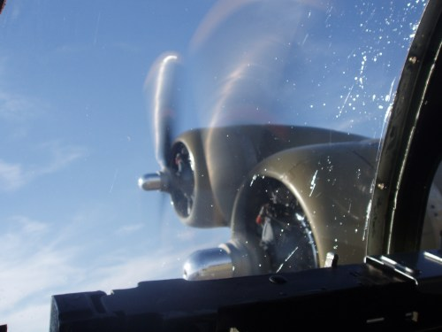 """Photo of #3 and #4 engines of Collings Foundation B-17G """"Nine-O-Nine"""" in the air"""