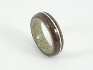 Antler and ebony ring with an offset silver inlay