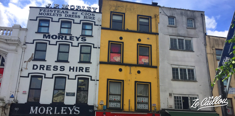Colorful town with many buildings, restaurants, pubs and shops in Cork