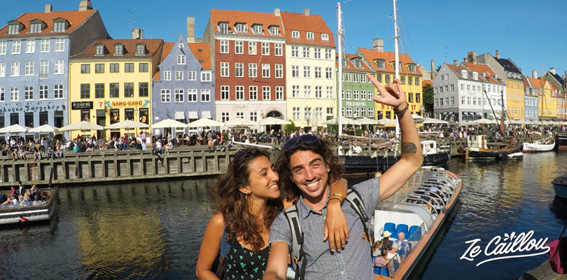 Nyhavn street, a touristic place in Copenhagen with its colorful houses and bars