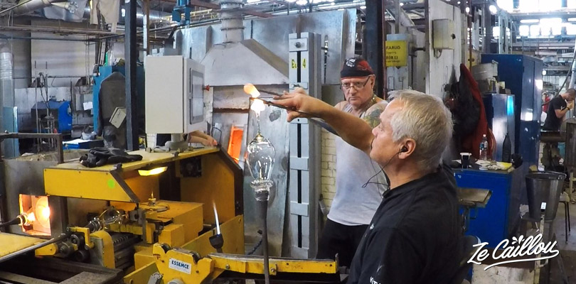 Look the glass blowers working with the molten glass in Sweden