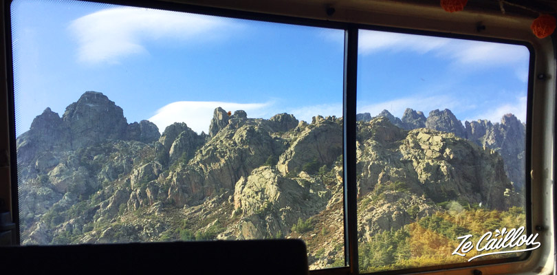 Sleep in front of the Bavella moutain during your road trip in Corsica in campervan.
